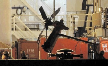 WRECKAGE: The tail section  of the   Super Puma is unloaded   at Aberdeen harbour  after the crash in which all 16 on board died