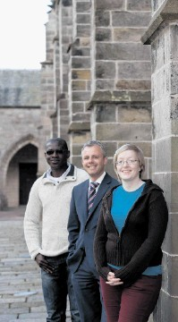 FUNDING PLEDGE:  Stewart Easton, centre, with operations geology students Benjamin Asante and Ellen Bell