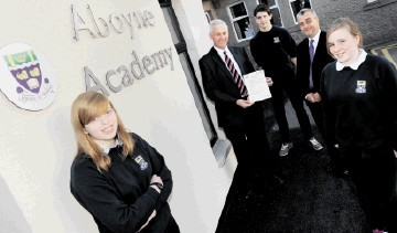 PRACTICAL UNDERSTANDING:  Clive Gregory, left, with  Raymond Jowett and Aboyne Academy pupils, from left, Kirsten Knight, 14, Stuart Masson, 14 and Emma Scott. Colin Rennie