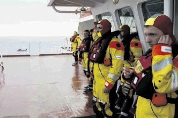 Rescued  –  safely aboard ship after the  Super Puma helicopter ditching