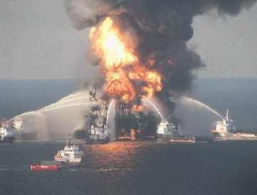 Coastguard and fire boats spray water on the blazing remnants of BP's Deepwater Horizon rig after the 2010 explosion