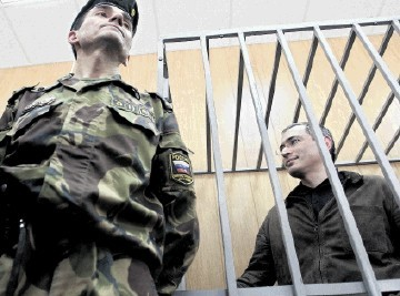 JAILED OLIGARCH: former CEO of Russian oil gaint Yukos, Mikhail Khodorkovsky stands  behind bars during a trial in Moscow