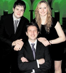 DEVELOPING NEXT GENERATION: Talisman UK exploration manager Matt Mulcahy  with scholarship recipients Ryan MacKenzie,  left,  and Clare Hyland