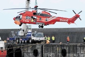 DITCHED: The Bond G-REDW being lifted off the Seven Pelican at Peterhead harbour. Kenny Elrick