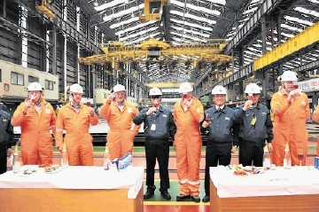 CAUSE FOR CELEBRATION: BP Clair Ridge . . . cutting first topsides steel in South Korea