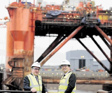 FORTUNES REVIVED: Energy Minister Fergus Ewing, left, and Roy MacGregor of Global at the yard. Sandy McCook