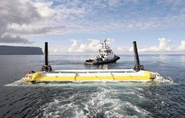 SURGING AHEAD: The Oyster 800  device is towed out for installation at  Emec's wave test site in Orkney