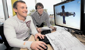 DEVELOPING TALENT: HES project engineer Clark Bain, left, with trainee design engineer William Rowe