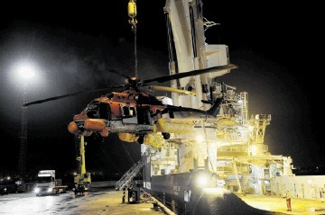 INVESTIGATION: The Super Puma EC225 helicopter which ditched in the sea in October arrives at Peterhead Harbour