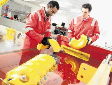 INCREASED INVESTMENT: Flexlife engineers at work on the company's Armadillo technology at its   R&D workshops in Aberdeen