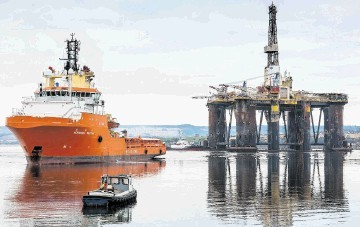 SAILING AWAY: The semi-submersible rig was tugged to Queens Dock and will now undergo a major refit benefiting the Easter Ross area