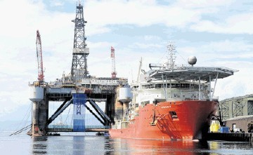 The oil rig Ocean Princess and the pipe-laying vessel Apache II in Invergordon Harbour