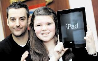 Shell Social Performance advisor John Raine presents competition winner Kirsty Taylor with her prize of an iPad for Hazelhead Academy