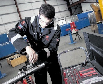 ENGINEERING: A Red Spider technician at work . . . Energy Ventures previously had a significant stake in the firm