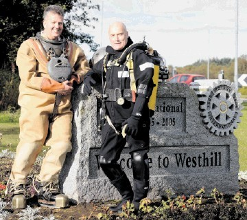 NEW ERA: Divex employees Bill Elrick, left, and Bob Thomson show past and present diving suits