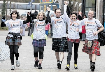 TOUCH OF TARTAN: Sponsored walkers during a previous charity event organised by The Kiltwalk