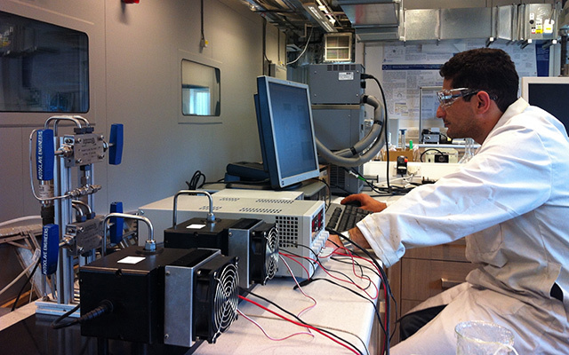 Saeid Mazloum working with a small-scale prototype of the HydraCHEK online hydrates monitoring device.