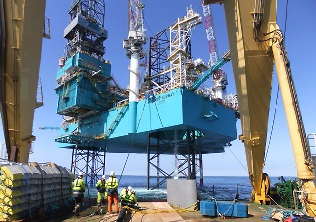 Construction work on Xcite's Bentley field with the Rowan Norway jack up rig in the background