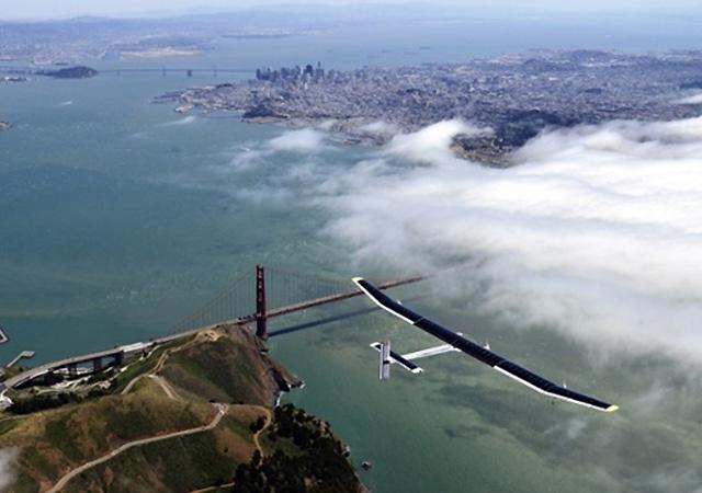 The sun-powered plane The Solar Impulse glides over San Francisco's Golden Gate Bridge.