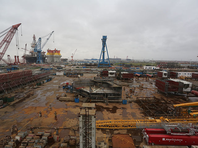 Centre of picture - Cosco Hull No. N487 - Hull blocks (keel to 5.5m level) located on COSCO QiDong #1 skid-way during assembly. Bottom left-hand corner of pic - next sequential hull block in readiness for lifting on to skid-way