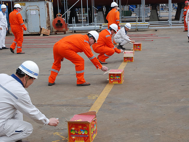 Keel laying at COSCO's QiDong yard near Shanghai marked by setting off traditional Chinese firecrackers