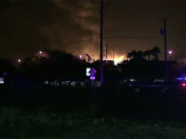 The skyline is lit up from explosions at the Blue Rhino propane plant in Florida