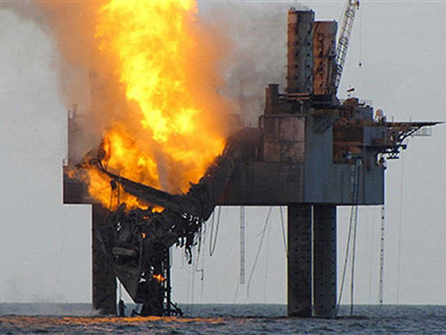 The fire catches hold on the Hercules 265 rig. Pic: US Coastguard