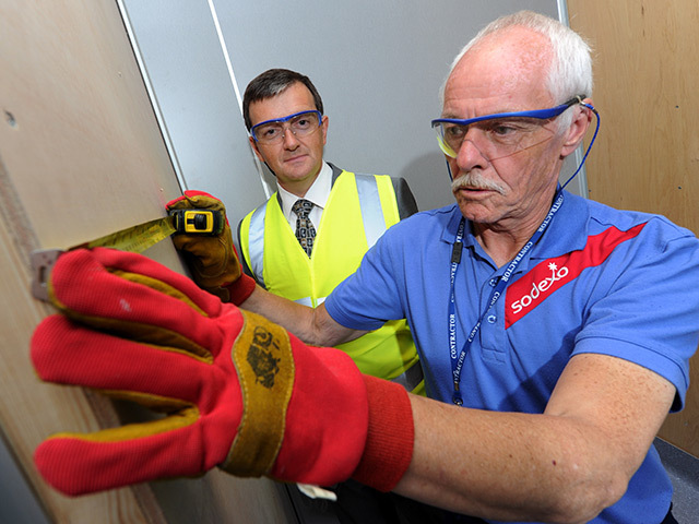 PROMOTED: Ian Russell, left, watches Sodexo colleagues at work. Pic: Kenny Elrick