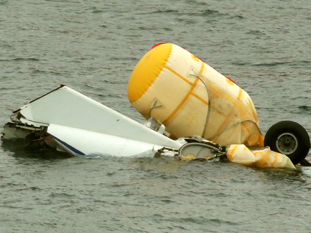 Wreckage of a crashed Super Puma floats in the water off Shetland