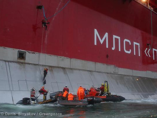 Greenpeace activists climb the rig. Pic: Denis Sinyakov/Greenpeace via Twitter