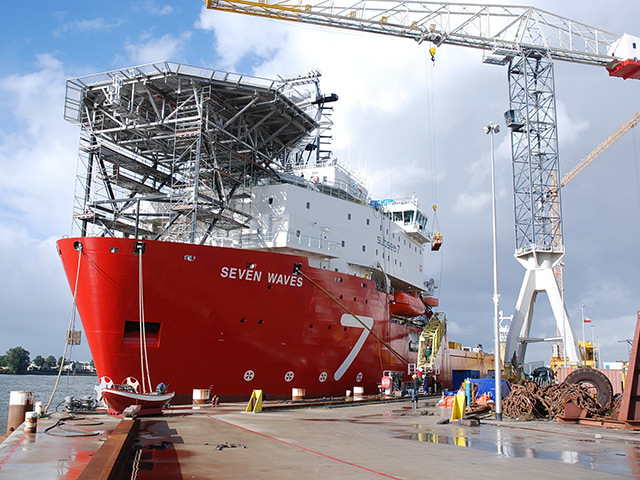 Construction ship Seven Waves in fitting out berth at the busy IHC Merwede