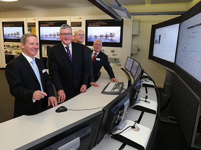 ABB regional service manager Mike Crawford shows Fergus Ewing MSP the offshore control room simulation