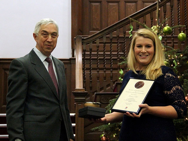 Kirsteen Bell receives prize from Stephen Glover, head of contracts expertise at Total E&P UK