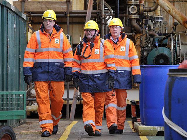 PM David Cameron (L) with BP regional president (North Sea) Trevor Garlick (R) and offshore installation manager Mark Furness, during a visit to the BP Etap platform
