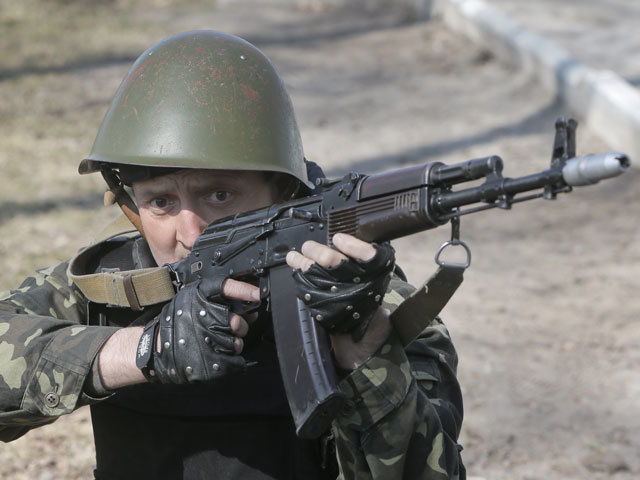 A self-defense activist performs military exercises at a military training ground outside Kiev, Ukraine