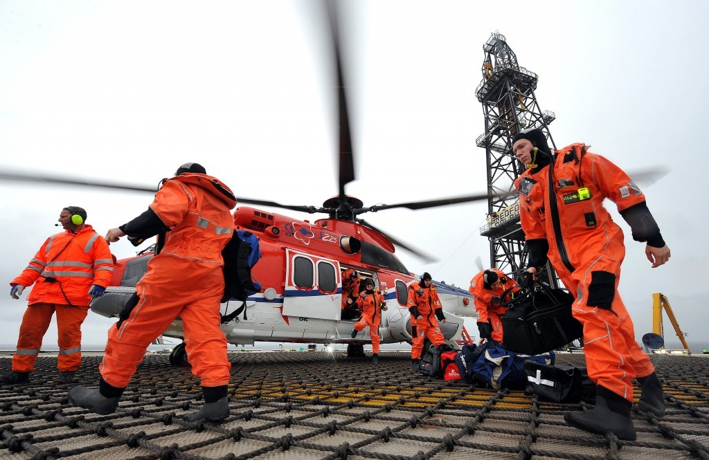 North Sea workers arrive on platform by helicopter