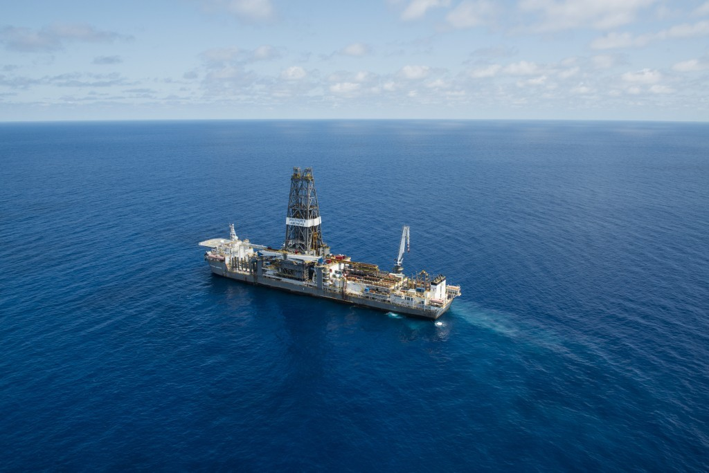 A drillship in blue seas, with a horizon