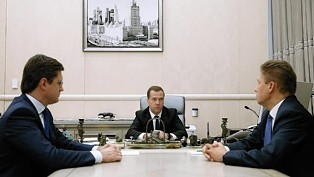 Russian Prime Minister Dmitry Medvedev, centre, in discussion with Energy Minister Alexander Novak, left, and Alexei Miller of Gazprom.