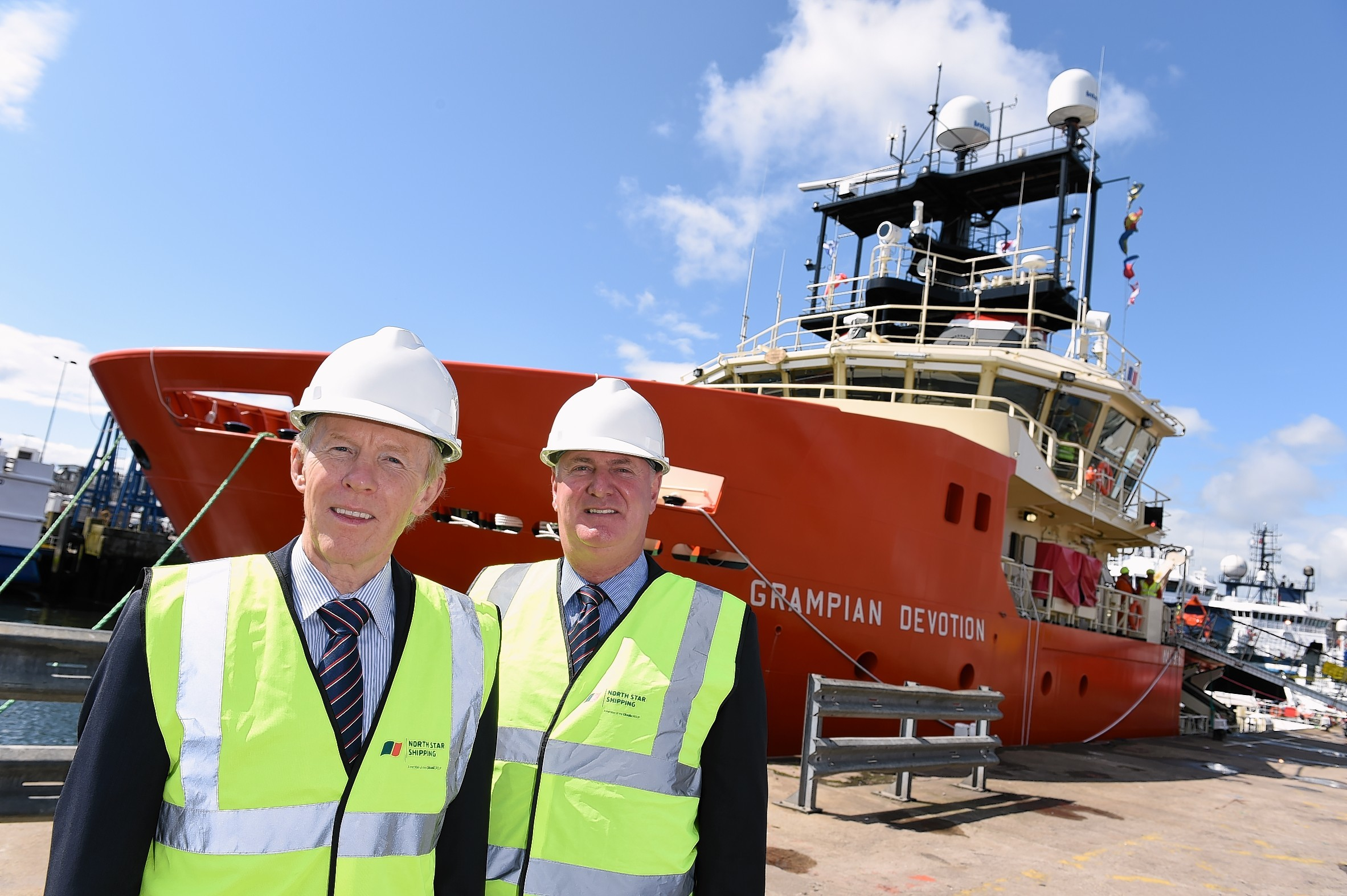 Douglas Craig, Craig Group chairman and managing director, left, and Callum Bruce, managing director of North Star Shipping standing on the quay in front of the Grampian Devotion.