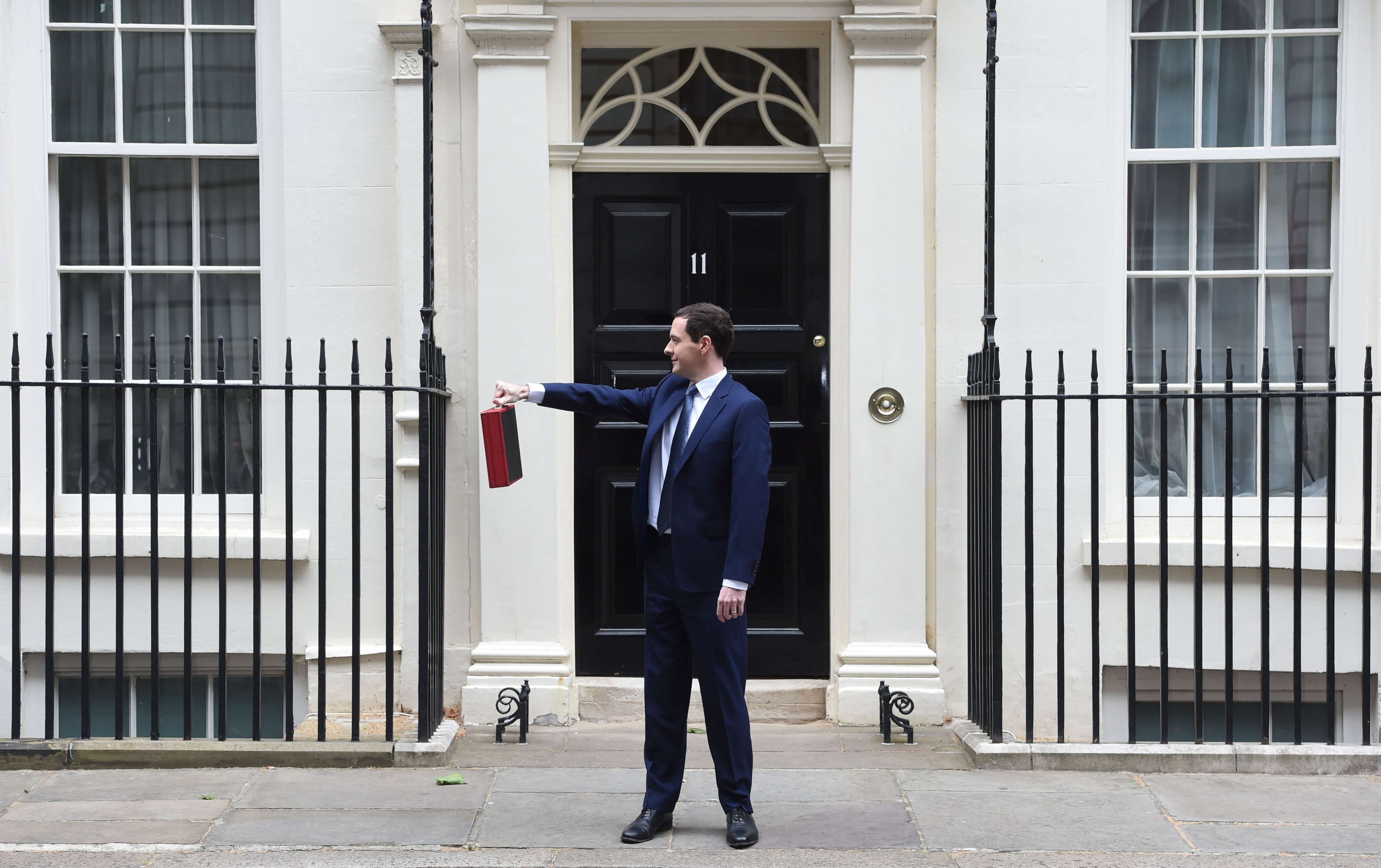 George Osborne holds his ministerial red box up to the media