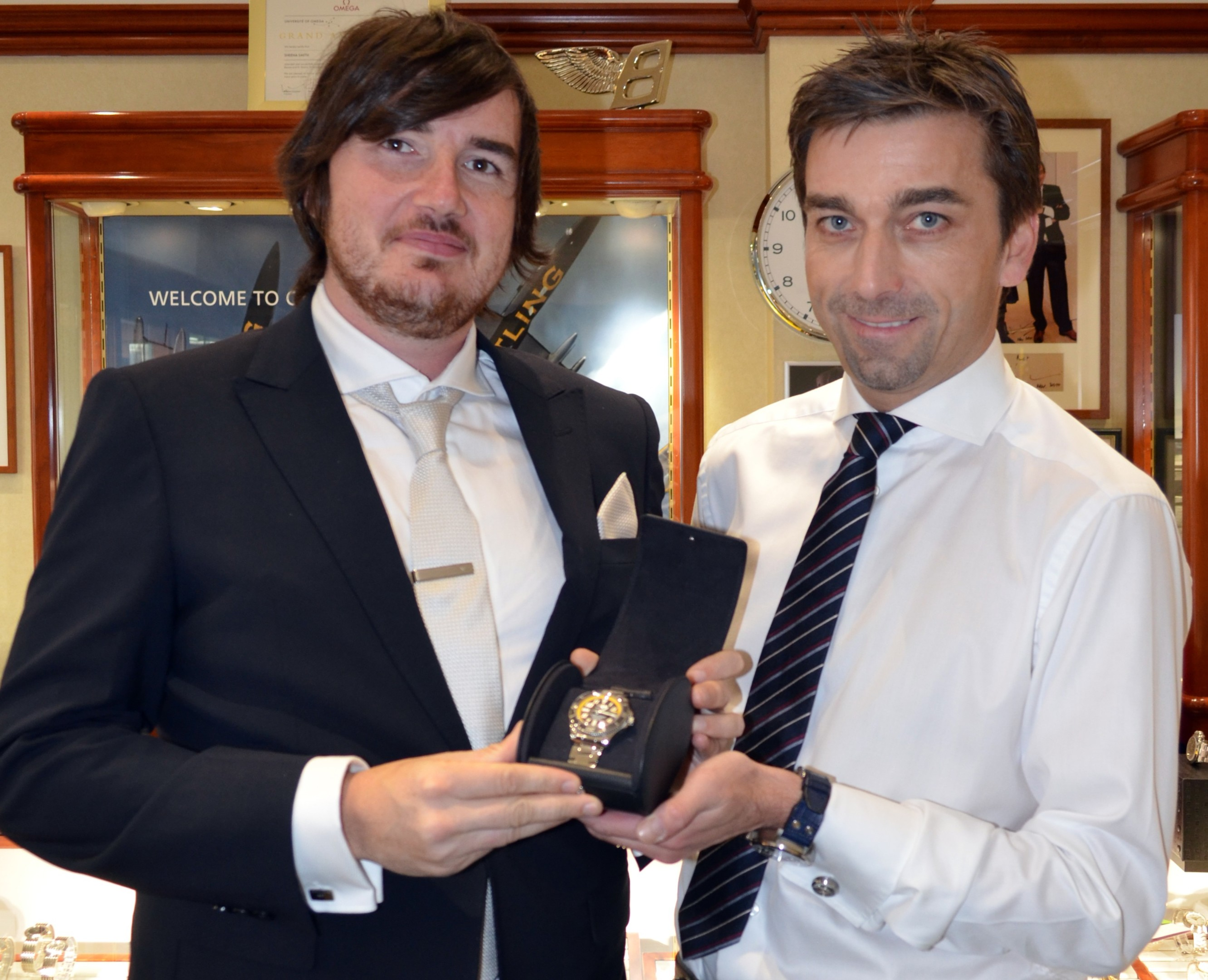 Jamie Gray, left, receives his Breitling from Matthew Finnie.