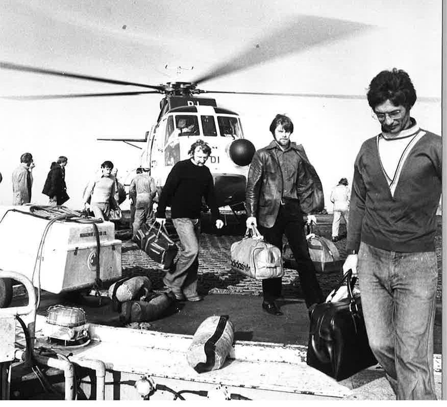 Oil workers in 1979 - years before safety improvements ensured those travelling in helicopters were required to wear survival equipment