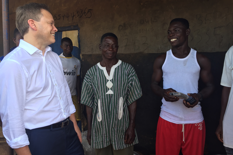 Grant Shapps talks to David and Gideon who have just had a PEG Ghana solar panel installed on their roof.