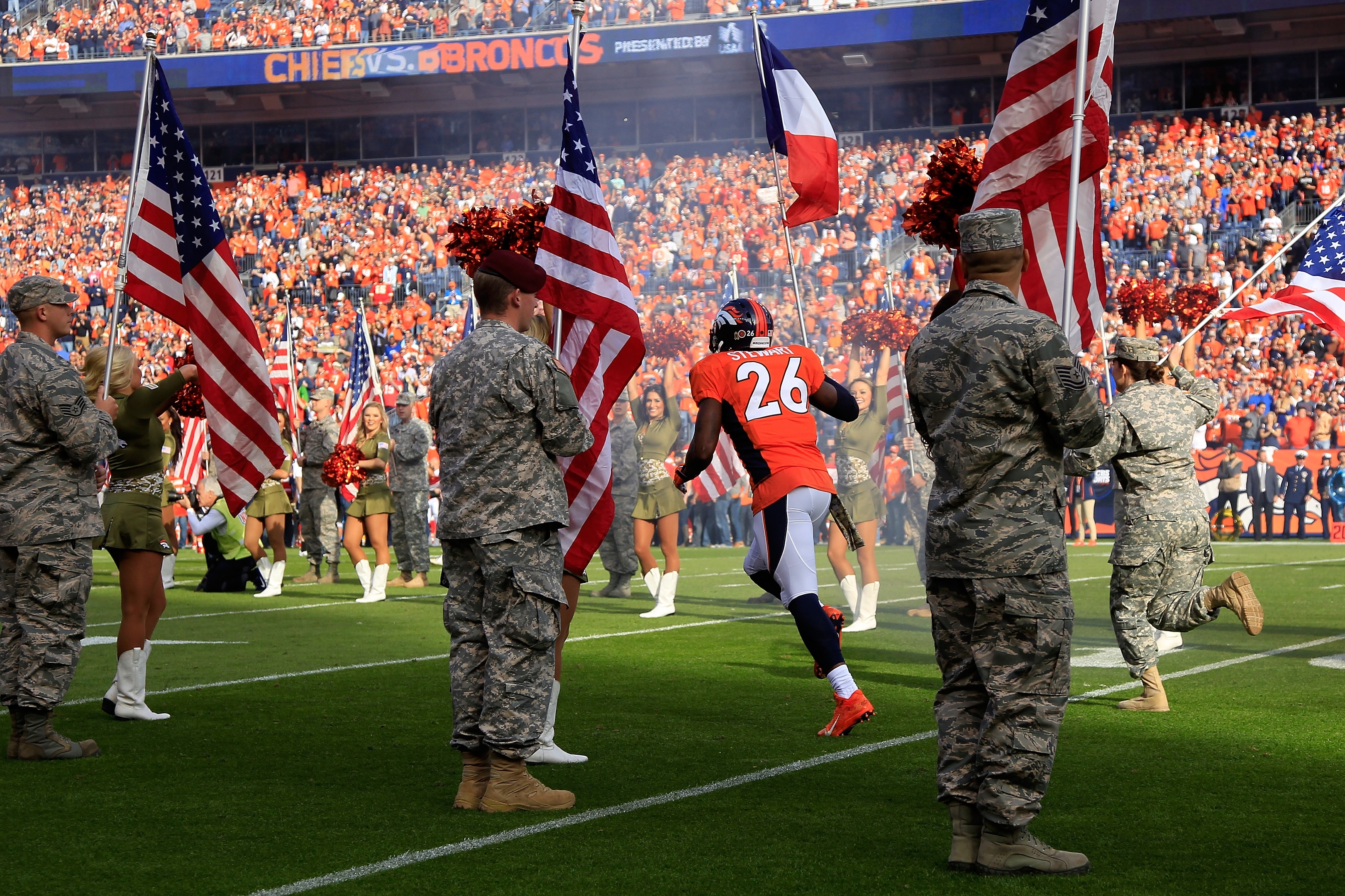 Darian Stewart #26 of the Denver Broncos carries the French flag onto the field in honor of the victims of the recent terrorist attacks in Paris prior to the game between the Kansas City Chiefs and the Denver Broncos as US Military Appreciation Day is observed at Sports Authority Field at Mile High on November 15, 2015 in Denver, Colorado