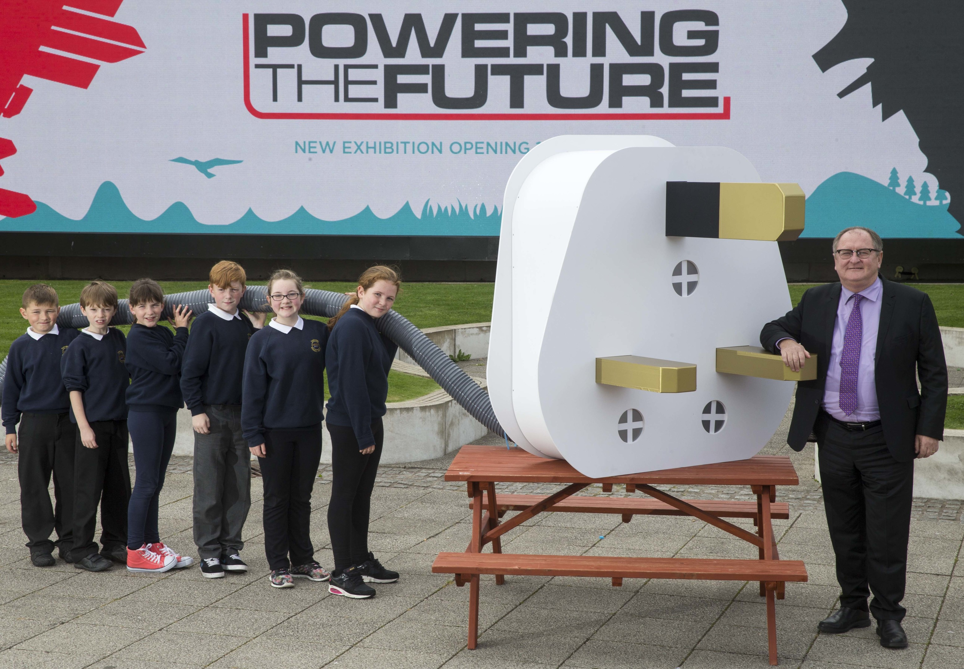 Opito managing director John McDonald with school pupils at the Glasgow Science Centre