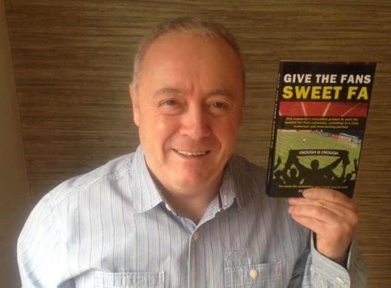 Peter Farrell holding his book, Give the Fans Sweet FA.