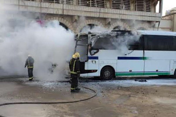 Armed men set Saudi Aramco bus on fire