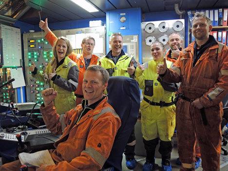 Statoil crew celebrate after drilling began on its flagship Johan Sverdrup