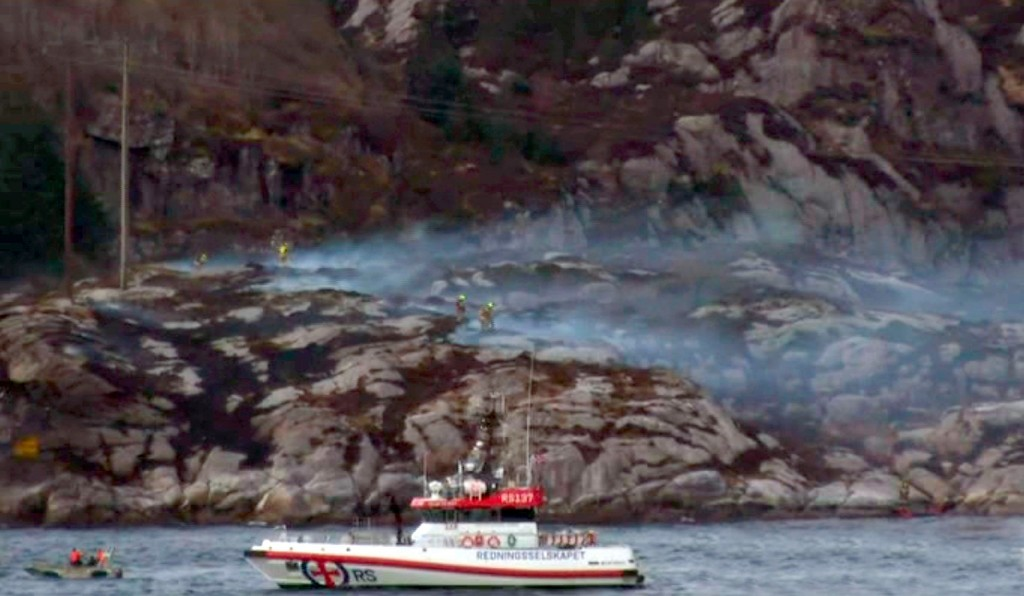 "Local TV images of the crash area - A helicopter has crashed west of the Norwegian city of Bergen with 13 people on board. There were reports of people in the sea, but a rescue official told broadcaster NRK that there were no signs of any survivors. The helicopter was ""totally destroyed"". Photos from the scene showed thick smoke coming from an area of rocky islets. It was flying from the Gullfaks oil field to Bergen. The western city is a centre for the North Sea oil and gas industry. The helicopter, a Eurocopter 225, came down near the small island of Turoy, just west of the village of Solsvik. Picture: NRK/Universal News And Sport (Europe) 29/04/2016."