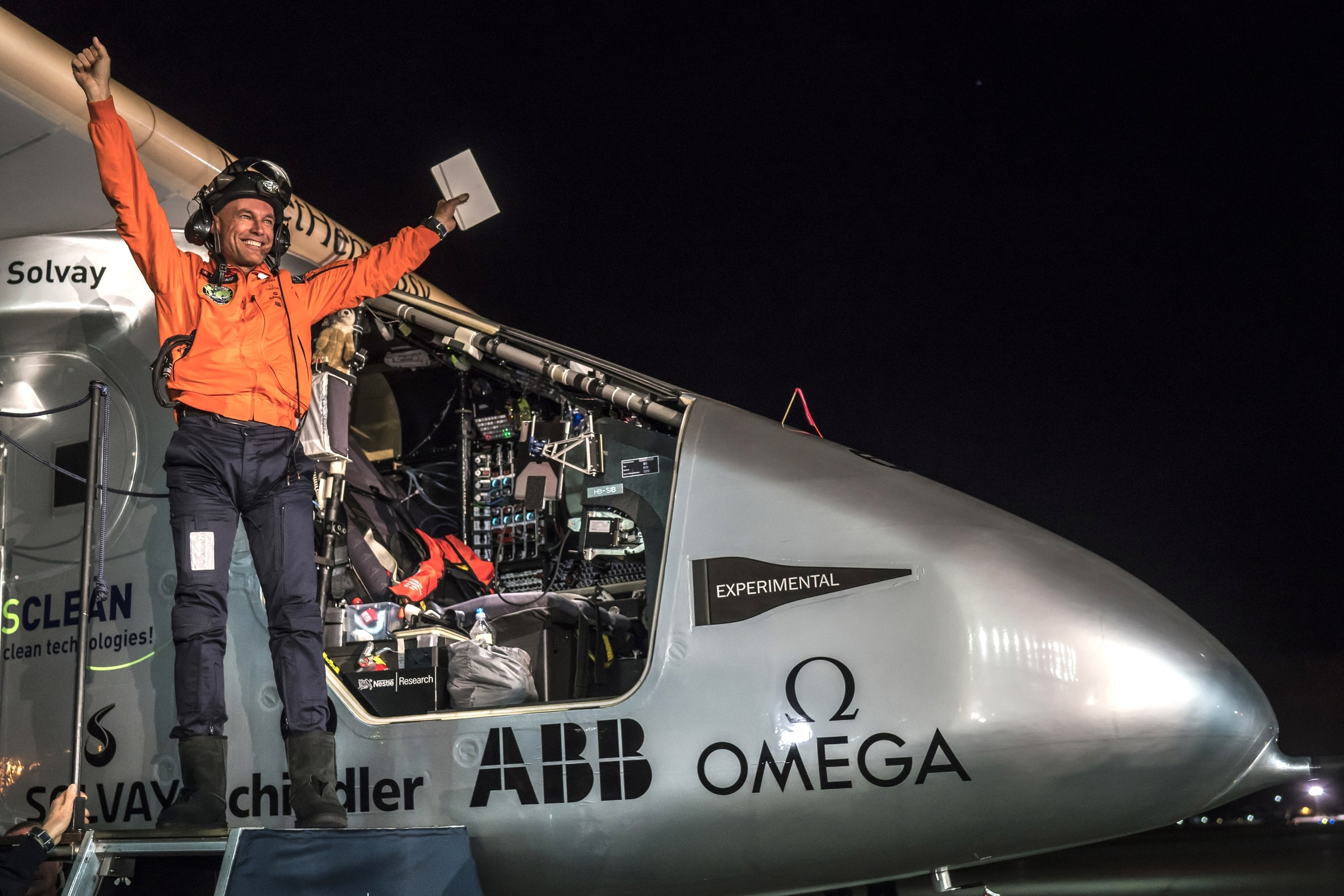 Swiss pilot Bertrand Piccard of Solar powered plane 'Solar Impulse 2', celebrates after a flight from Hawaii during its circumnavigation, at Moffett Airfield  in Silicon Valley, on April 23, 2016 in Mountain View, California. The Solar Impulse 2 is equipped with 17,000 solar cells, has a wingspan of 72 metres, and yet weighs just over 2 tonnes.